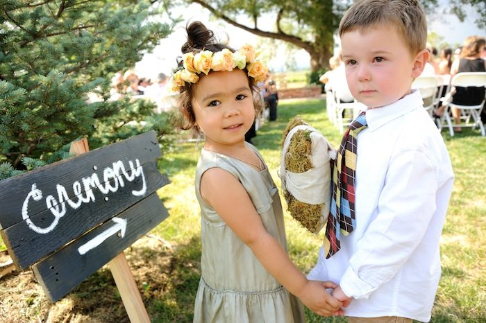 Little flower girl and ring bearer at a Longmont farm-to-table wedding outside in Colorado. beautiful-longmont-farm-wedding-hot-summers-day-kiefel-photography