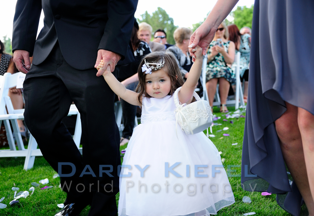 The flower girl walking down the aisle